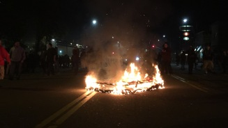 A mattress burns on Telegraph Avenue in Oakland during protests Nov. 25, 2014. (Alex Emslie/KQED)