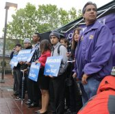 Saul Almanza, BART track safety trainer and SEIU 1021 vice president of BART professional chapter, stands at a June 25 rally at 24th and Mission streets in San Francisco calling attention to safety issues the union says are plaguing the BART system. PHOTO BY ALEX EMSLIE / KQED