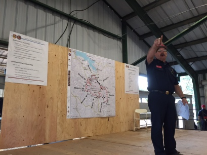 Cal Fire Planning Chief Rob Daugherty conducts the morning briefing Sept. 15 for crews headed to battle the Valley Fire.