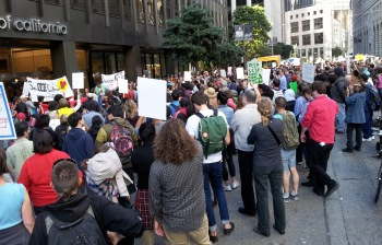 About a thousand people calling on federal authorities to intervene in City College of San Francisco's accreditation crisis arrive at the U.S. Department of Education offices in San Francisco July 9. PHOTO BY ALEX EMSLIE / KQED