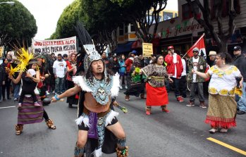 Aztec dancers at Saturday's march for 28-year-old Alejandro Nieto, who was shot and killed by police officers a week before. (Alex Emslie/KQED)