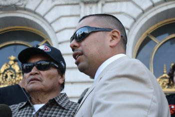 Alejandro Nieto's father, Refugio Nieto, (left) and friend Ben Bac Sierra talk to reporters outside San Francisco City Hall after filing a wrongful death claim against the city on Monday, April 14. (Alex Emslie/KQED)