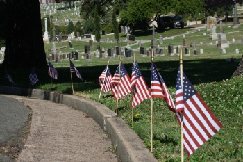 Flags line the path to a Memorial Day commemoration at Mountain View Cemetery in Oakland on May 26, 2014. (Alex Emslie/KQED)