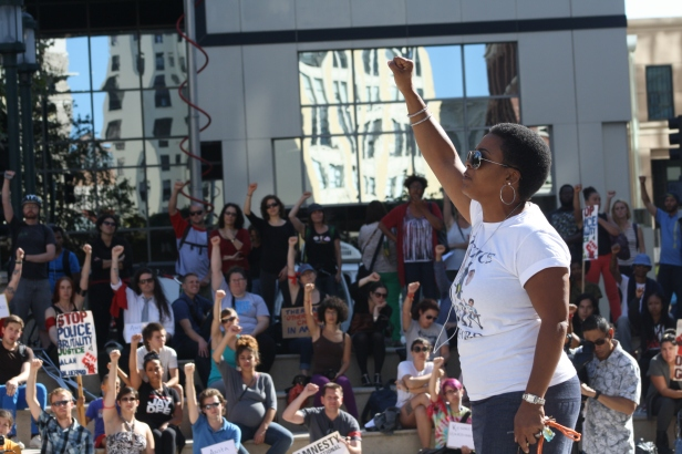 Jeralynn Blueford speaks to the crowd at an Aug. 14 Oakland vigil for people killed by police. (Alex Emslie/KQED)