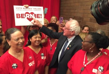 Presidential hopeful and Vermont Sen. Bernie Sanders arrives to accept the endorsement of the National Nurses United union in Oakland on Aug. 10. (Alex Emslie/KQED)