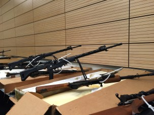 Assault rifles were part of a cache of 38 firearms seized when San Francisco police served a search warrant with San Mateo SWAT officers in South San Francisco, June 3. (Alex Emslie/KQED)