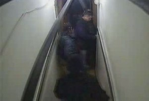An image from Henry Hotel security camera footage shows SFPD Officer Arthur Madrid inserting a key into the door of Room 504. Officer Arshad Razzak is directly to Madrid's right, and Officer Richard Yick is in the foreground. Madrid's partner, Robert Forenis, is to his left. (Courtesy of the San Francisco Public Defender's Office)