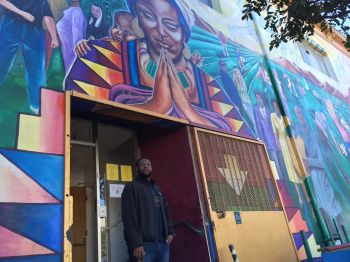Kenneth Hill, who lives in San Francisco's Bayview neighborhood, stands outside his office, near the location of the new grocery store. (Alex Emslie/KQED)