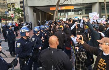 A march protesting the fatal police shooting of Mario Woods were stopped by a line of San Francisco officers about a block away from the Super Bowl City. (Alex Emslie/KQED)