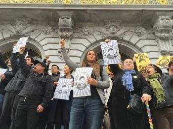 "Members of the Justice for Mario Woods Coalition gathered outside San Francisco City Hall after shouting at Mayor Ed Lee to ""fire Chief Suhr"" during his inauguration speech Friday. (Alex Emslie/KQED)"