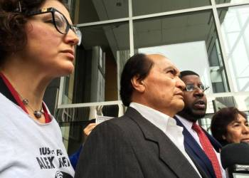 (L-R) Supporters Adriana Camarena, Refugio Nieto, Adante Pointer and Elvira Nieto speak to reporters after closing arguments March 9 in a civil trial over the fatal police shooting of Alejandro Nieto. (Alex Emslie/KQED)