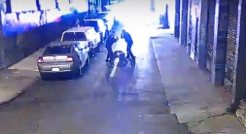 A screenshot from security camera video showing two Alameda County sheriff's deputies beating Stanislav Petrov on Nov. 12, 2015.