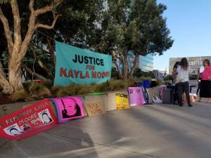 Supporters of Kayla Moore's family gather outside the Phillip Burton Federal Building and United States Courthouse in San Francisco on Oct. 17. (Alex Emslie/KQED)